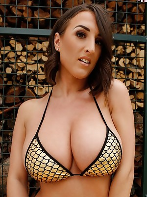 34G Stacey Poole does a striptease for a naughty photographer