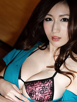 Julia Asian dame takes clothes off and shows her huge knockers