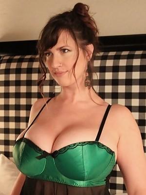 Lana Kendrick teasing in bed wearing her green bra