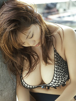 Asian babe showing off her big plump juicy tits in lace lingerie