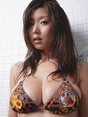 Sizzling asian beauty shows off her big busty tits in a bikini