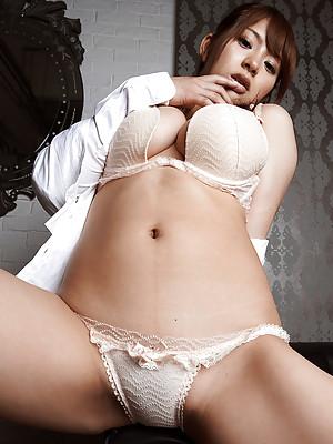 Meguri Asian in tight skirt shows her huge knockers in white bra