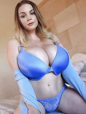 34J Holly Garner is incredibly busty and very sexy coming out of her bra