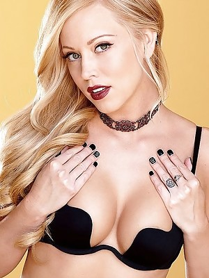 Glamorous Brea Bennett plays with dildo in stockings and heels