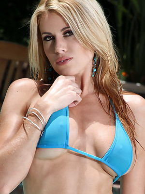 Randy Moore Gets All Wet in Turquoise Thong Bikini